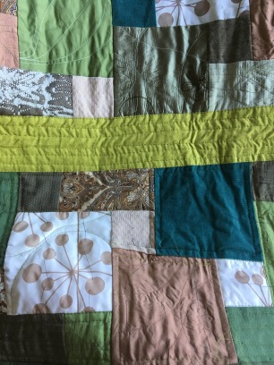 Front with lower half and green bar quilted, top yet to be done.
